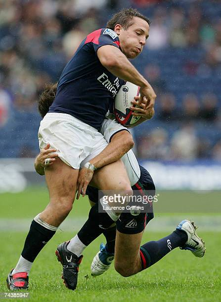 Pedro Silva of Portugal tackles Andrew Vilk of England during the IRB Edinburgh Sevens Bowl Final match between England and Portugal at Murrayfiled...