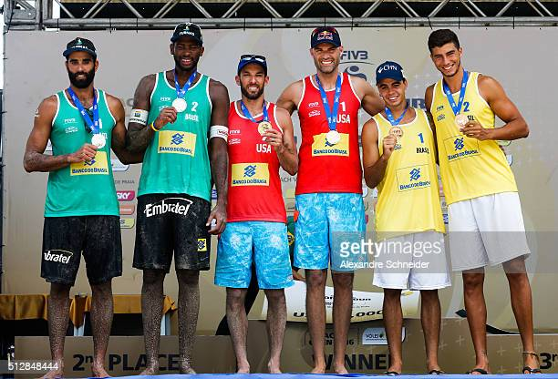 Pedro Solberg and Evandro Goncalves of Brazil show the solver medal Nick Lucena and Phil Dalhausser of the United States show the gold medal and...