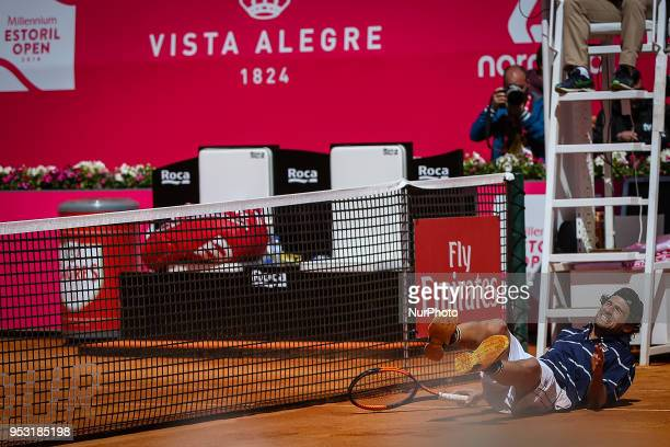 Pedro Sousa from Portugal returns a ball to Gilles Simon from France during the Millennium Estoril Open tennis tournament in Estoril outskirts of...
