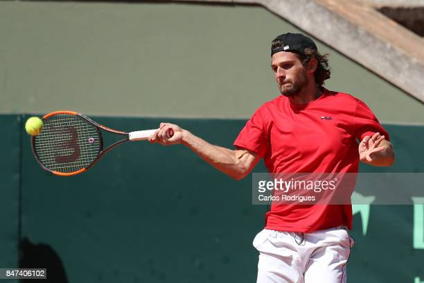 Pedro Sousa of Portugal in action against Jan Lennard Struff of Germany during day one of the Davis Cup World Group Playoff between Portugal and...