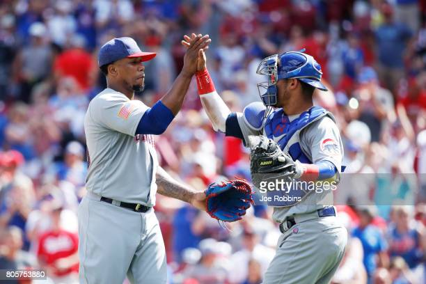 Pedro Strop and Willson Contreras of the Chicago Cubs celebrate after the final out in the ninth inning of a game against the Cincinnati Reds at...
