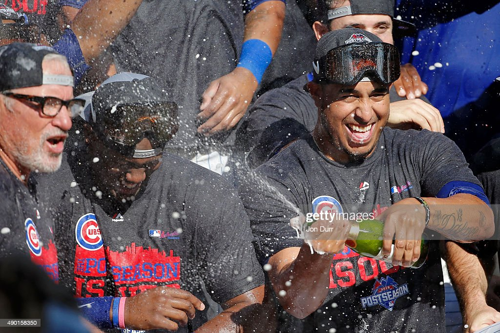 Pedro Strop #46 of the Chicago Cubs (R) celebrates with manager Joe Maddon #70 (L) after clinching their Wildcard position after their game against the Pittsburgh Pirates at Wrigley Field on September 26, 2015 in Chicago, Illinois.