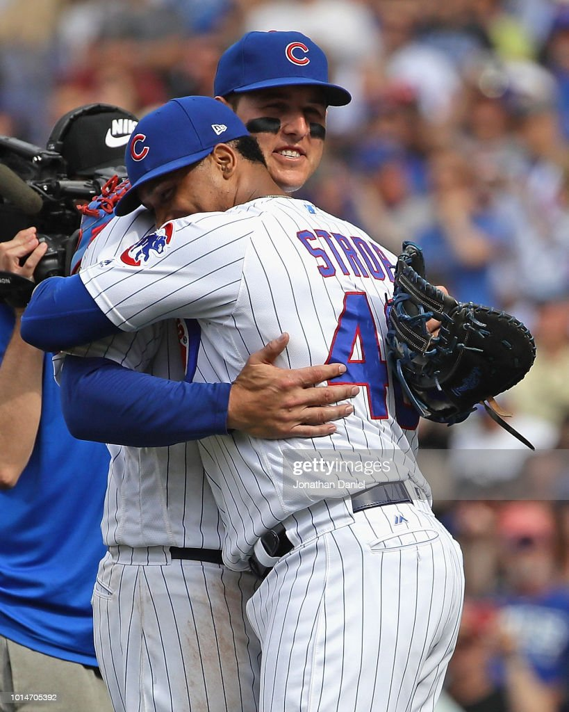 Pedro Strop #46 of the Chicago Cubs hugs Anthony Rizzo #44 after a win over the Washington Nationals at Wrigley Field on August 10, 2018 in Chicago, Illinois. The Cubs defeated the Nationals 3-2.