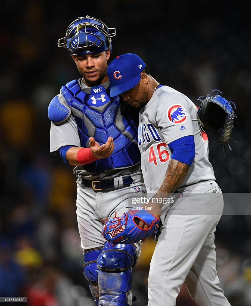Pedro Strop #46 of the Chicago Cubs hugs Willson Contreras #40 after the final out in a 1-0 win over the Pittsburgh Pirates at PNC Park on August 16, 2018 in Pittsburgh, Pennsylvania.