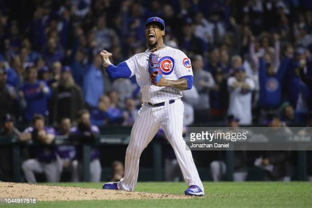 Pedro Strop of the Chicago Cubs reacts after striking out Ian Desmond of the Colorado Rockies in the ninth inning during the National League Wild...