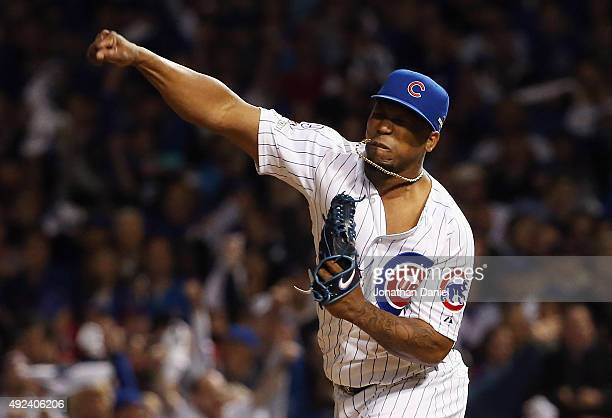 Pedro Strop of the Chicago Cubs reacts in the eighth inning against the St Louis Cardinals during game three of the National League Division Series...