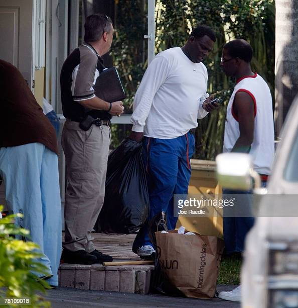 Pedro Taylor the father of Washington Redskins football player Sean Taylor carries material from the home that his son was killed in a day earlier...