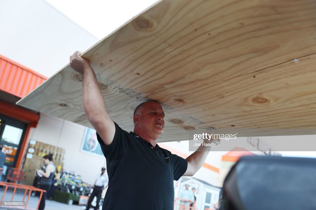 Pedro Toledo purchases plywood at The Home Depot as he prepares for Hurricane Irma on September 6, 2017 in Miami, Florida. It's still too early to know where the direct impact of the hurricane will take place but the state of Florida is in the area of possible landfall.