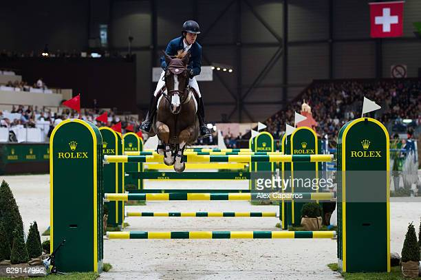 Pedro Veniss of Brazil on Quabri de l'Isle rides for the victory during the Rolex Grand Slam of Show Jumping at Palexpo on December 11, 2016 in...