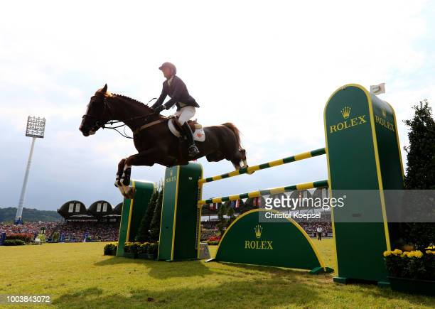 Laura Klaphake of Germany rides on Catch me if you can during the Rolex Grand Prix of CHIO Aachen 2018 at Aachener Soers on July 22 2018 in Aachen...