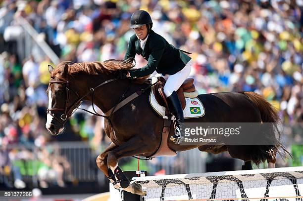 Pedro Veniss of Brazil rides Quabri de L'Isle during the Jumping Team Round 2 on Day 12 of the Rio 2016 Olympic Games at the Olympic Equestrian...