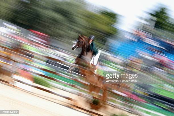 Pedro Veniss of Brazil rides Quabri De L'Isle during the Team Jumping on Day 11 of the Rio 2016 Olympic Games at the Olympic Equestrian Centre on...