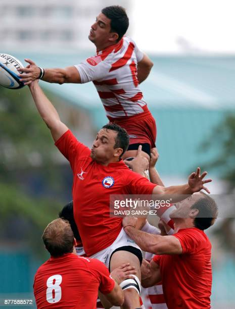 Pedro Verschae of Chile and Horacio Aguero of Paraguay jump for the ball in a line out in the men's rugby final during the XVIII Bolivarian Games...