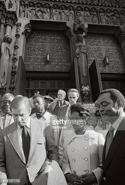 Pee Wee Reese and Monte Irvin former baseball players join other mourners as they leave the Riverside Church where they paid their respects to former...