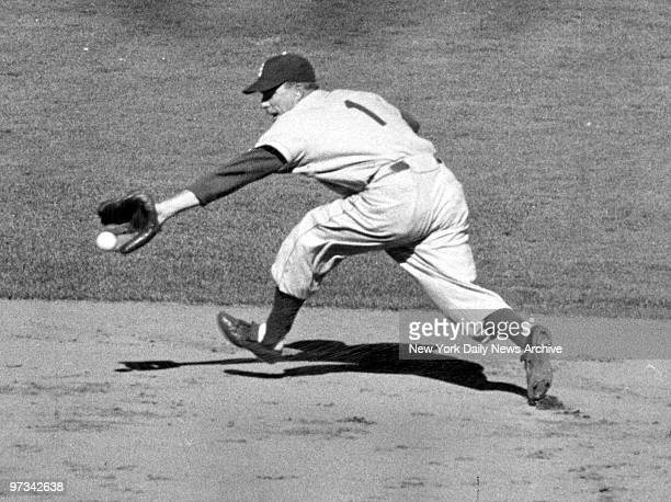 Pee Wee Reese of the Brooklyn Dodgers takes a sixinning hit away from Phil Rizzuto of the New York Yankees with a running backhanded stop of grounder...
