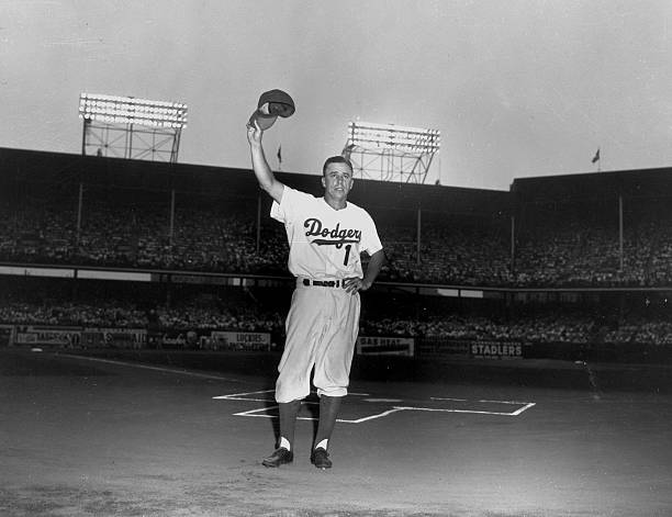 Pee Wee Reese waves to fans during Pee Wee Reese Day at Ebbe