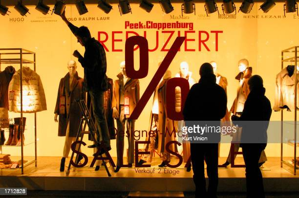 Peek Cloppenburg employee puts the final touches on a window display January 7 2002 in Berlin With GDP growth estimated at 03% in 2002 and expected...