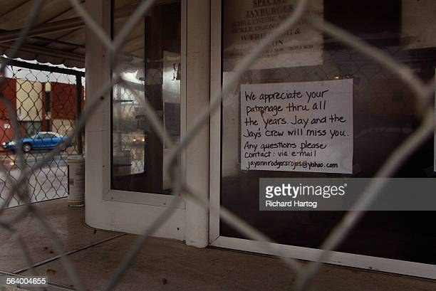 A peek through the fence at the legendary Jay's Jayburger stand Thursday afternoon in Hollywood Owner JayAnn Rodgers–Rojas has been fenced out of her...