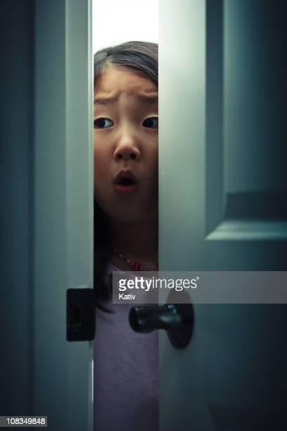 Peeking Fearfully behind a Door