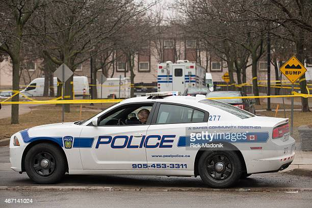 MISSISSAUGA MARCH 21 Peel Police and the Special Investigations Unit investigate a scene in Mississauga where one person is dead and two police...