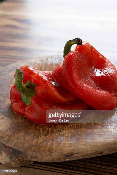 peeled and roasted red peppers - roasted pepper stock photos and pictures