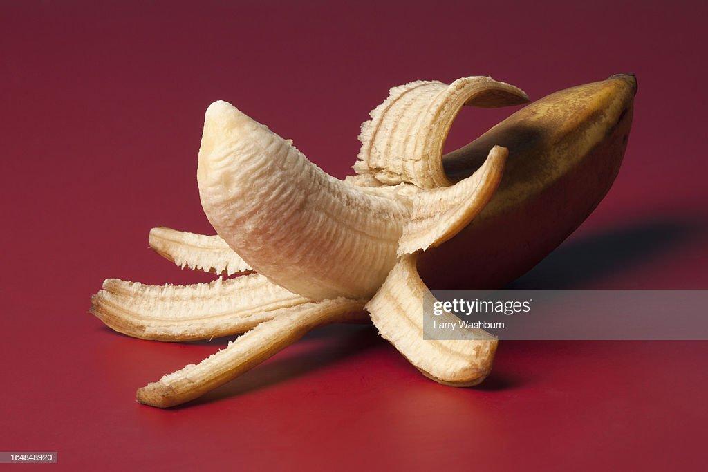 A peeled banana suggestive of an erect penis : Stock Photo
