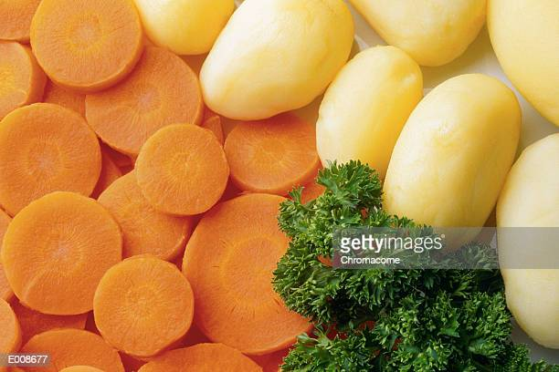 Peeled potatoes and carrots with fresh parsley