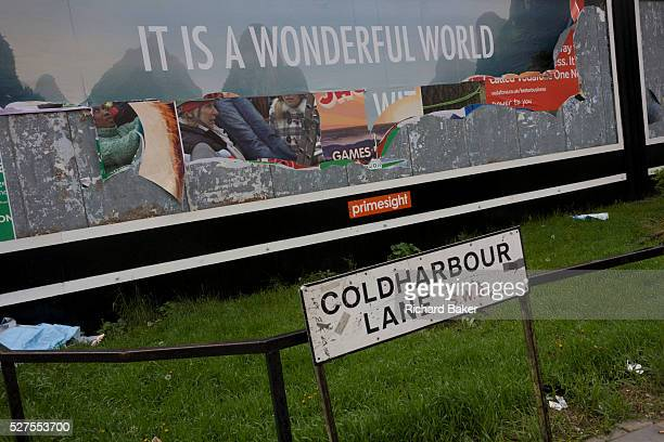 """Peeling billboard reveals older layers of Primesight street advertising incl the dystopian message """"It's a wonderful world."""" The differences between..."""