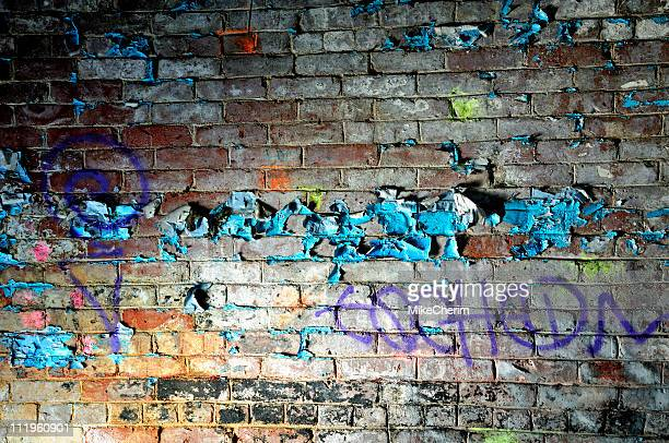 Peeling Paint on Graffiti Wall