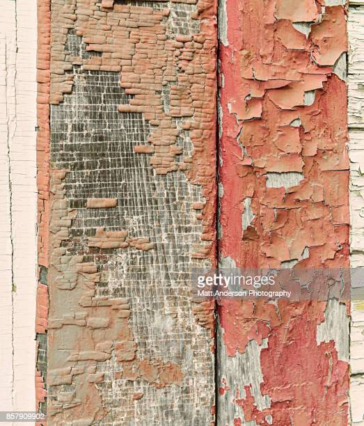 Peeling paint on the side of a building