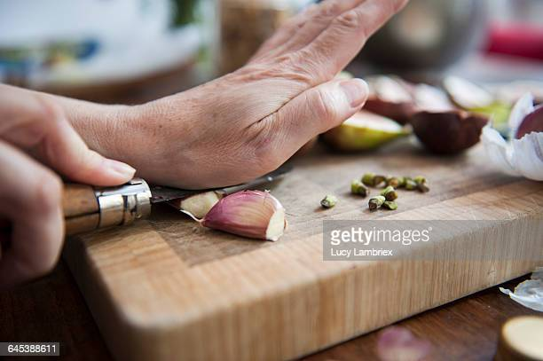 peeling the garlic - crushed stock pictures, royalty-free photos & images