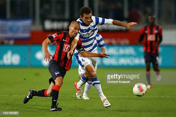 Peer Kluge of Berlin challenges Goran Sukalo of Duisburg during the Second Bundesliga match between MSV Duisburg and Hertha BSC Berlin at...