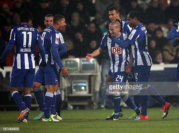 Peer Kluge of Berlin jubilates with team mates after scoring the first goal during the Second Bundesliga match between FC Energie Cottbus and Hertha...