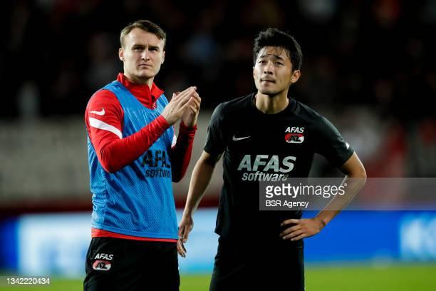 Peer Koopmeiners of AZ and Yukinari Sugawara of AZ look dejected during the Dutch Eredivisie match between FC Twente and AZ at De Grolsch Veste on...