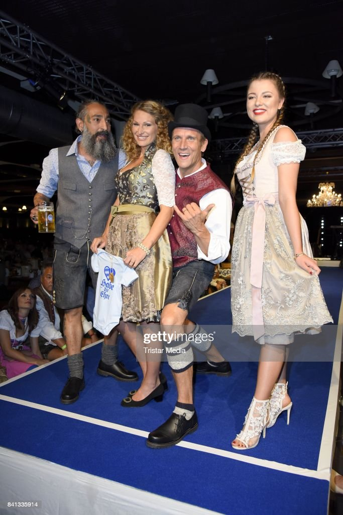 Peer Kusmagk, his girlfriend Janni Hoenscheid, Senay Gueler and Joelina Drews during the Angermaier Trachten-Nacht at Hofbraeuhaus on August 31, 2017 in Berlin, Germany.