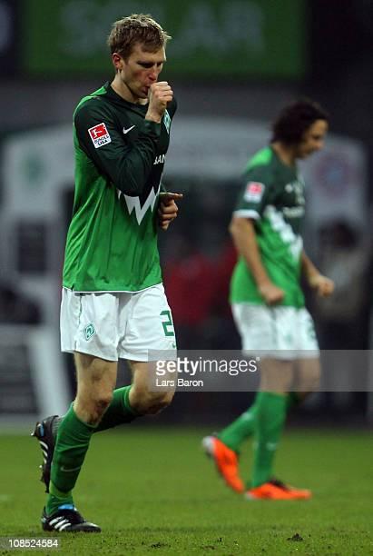 Peer Mertesacker of Bremen celebrates after scoring the first goal during the Bundesliga match between SV Werder Bremen and FC Bayern Muenchen at...