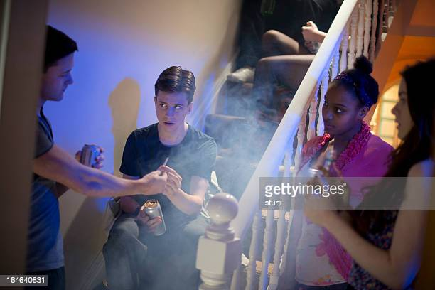 peer pressure at a house party - adolescence stock pictures, royalty-free photos & images