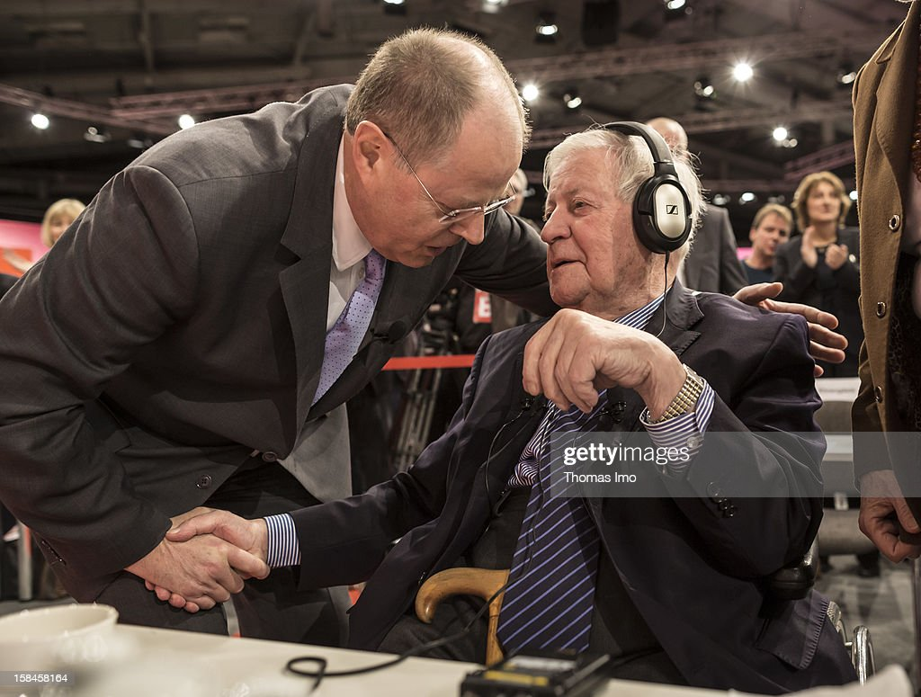 Peer Steinbrueck (L), chancellor candidate of the German Social Democrats (SPD) shakes hands with former federal chancellor Helmut Schmidt after his speech at the SPD federal party convention on December 9, 2012 in Hanover, Germany. The SPD is convening to set its policy course for the next year and to celebrate Steinbrueck, who will run for chancellor in elections set for 2013.