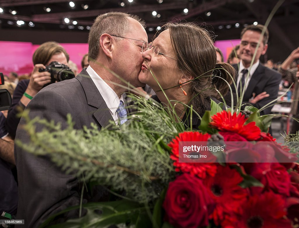 Peer Steinbrueck, chancellor candidate of the German Social Democrats (SPD), kiss his wife Gertrud after his speech at the SPD federal party convention on December 9, 2012 in Hannover, Germany. The SPD is convening to set its policy course for the next year and to celebrate Steinbrueck, who will run for chancellor in elections set for 2013.