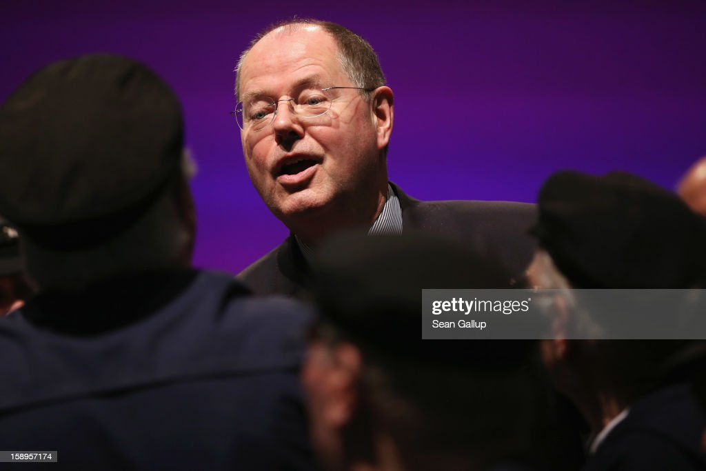 Peer Steinbrueck, chancellor candidate of the German Social Democrats (SPD), greets members of an East Frisian men's choir at the end of a Lower Saxony SPD state election rally on January 4, 2013 in Emden, Germany. Lower Saxony is holding state elections on January 20 and many analysts see the election as a bellwether for national elections, in which Steinbrueck will run for chancellor, scheduled to take place later this year.