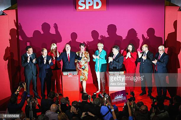 Peer Steinbrueck chancellor candidate of the German Social Democrats chairman Sigmar Gabriel and leading fellow party members react after initial...