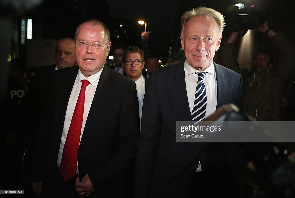Peer Steinbrueck (L), chancellor candidate of the German Social Democrats (SPD), and Juergen Trittin, co-lead candidate of the German Greens Party (Buendnis 90/Die Gruenen), arrive for the Elefantenrunde live television broadcast at ZDF studios following federal elections in which the German Christian Democrats (CDU) received 42% of the vote on September 22, 2013 in Berlin, Germany. Germany is holding federal elections that will determine whether current Chancellor Angela Merkel of the German Christian Democrats (CDU) will remain for a third term. Though the CDU has a strong lead over the opposition, speculations run wide as to what coalition will be viable in coming weeks to create a new government.