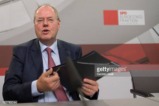 Peer Steinbrueck German Social Democrat and former Finance Minister looks on after he presented his proposal for reforming financial institutions in...