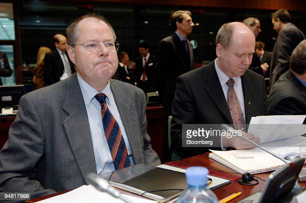Peer Steinbrueck the German finance minister left and Eero Heinaeluoma the Finnish minister of finance pause before the start of the EcoFin meeting...