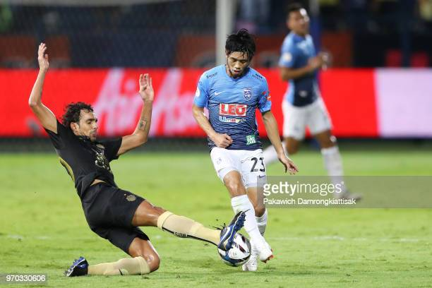 Peeraphong Pichitchotirat of Bangkok Glass FC is tackled by Diogo Luis Santo of Buriram United FC during the Thai League 1 match between Bangkok...