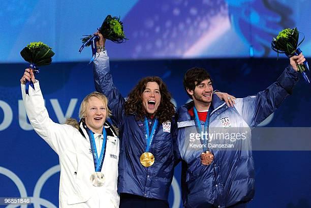 Peetu Piiroinen of Finland celebrates winning the Silver Shaun White of United States Gold and Scott Lago of United States Bronze during the medal...
