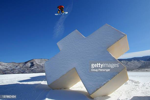 Peetu Piiroinen of Finland soars over a feature during men's snowboard slopestyle practice during Winter X Games 2012 at Buttermilk Mountain on...