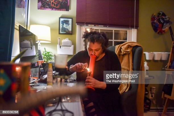 Peg Nottingham of Gaithersburg MD smokes a strain of medical marijuana called Northern Lights that she received today from Potomac Holistics on...