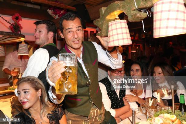 Pegah Ghaemi and Erol Sander during the Oktoberfest at Theresienwiese on September 21 2017 in Munich Germany