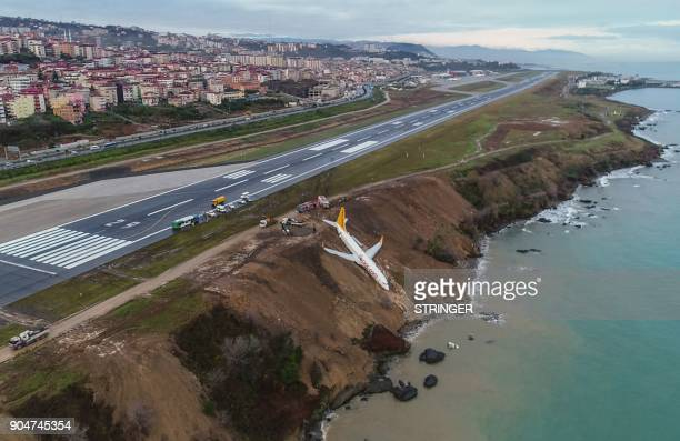 Pegasus Airlines Boeing 737 passenger plane is seen struck in mud on an embankment a day after skidding off the airstrip after landing at Trabzon's...